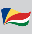 flag of seychelles waving on gray background vector image vector image
