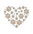 brown paw prints in heart shape vector image