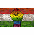 lgbt protest fist on a hungary brick wall flag vector image vector image