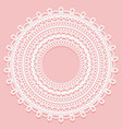Round doily on a pink background openwork lace
