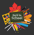 green chalkboard and school supplies vector image