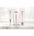 beauty cosmetics bottles line on marble table top