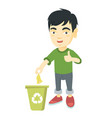 little boy throwing banana peel in recycling bin vector image