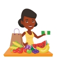 Woman standing at the table with shopping bag vector image