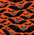 Vampire bats on orange background vector image vector image