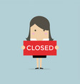 businesswoman hold a sign closed in her hands vector image vector image