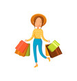 young happy woman wearing in a hat with shopping vector image