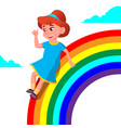 happy child girl rolling down the rainbow vector image vector image