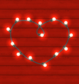 Garland heart shaped on red wooden background for