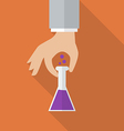 Hand holding chemistry bulb vector image