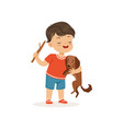 cute bully boy teasing little dog hoodlum vector image