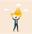 business man holding up golden cup over head vector image