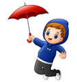 little boy with red umbrella jumping vector image vector image