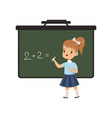 girl writing english letters on blackboard vector image vector image