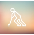 Hockey player pushing the puck thin line icon vector image