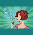 young woman blowing bubbles vector image