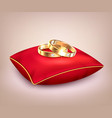 wedding rings on red ceremonial pillow vector image vector image