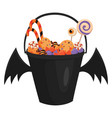a halloween bucket with bat wings filled with vector image vector image