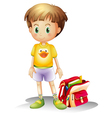A young boy with his school bag vector image
