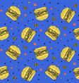 bright pattern with yellow burgers on blue vector image vector image