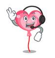 with headphone ballon heart mascot cartoon vector image