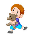 a boy happy play with the grey teddy bear vector image