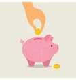 Hand down a coin in piggy Bank vector image