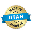 Made in utah gold badge with blue ribbon