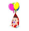a baby enjoy under a balloon vector image vector image