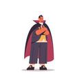cute man standing in dracula costume happy vector image
