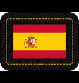 flag of spain icon on black leather backdrop vector image