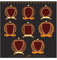 Insignia designs set shields laurel wreaths and ri vector image vector image