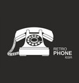 white vintage telephone isolated on black vector image vector image