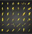 yellow lightning set isolated on black background vector image vector image