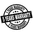 5 years warranty round grunge black stamp vector image vector image