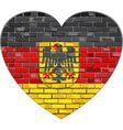 German flag on a brick wall in heart shape vector image