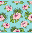 Pattern with tropical leaves and flowers on a