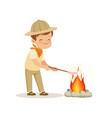 cute little boy in scout costume frying his vector image vector image