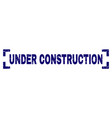 grunge textured under construction stamp seal vector image vector image