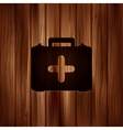 first aid kit icon Wooden background vector image