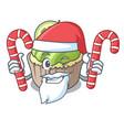 santa with candy lemon cupcake mascot cartoon vector image