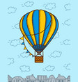hot air ballon flies in clouds vector image
