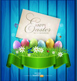 easter eggs with greeting card grass and flowers vector image