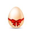 Easter paschal egg with red bow isolated on white