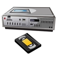 Old cassette video player and videocassette vector image