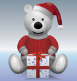 Teddy bear white in red sweater and red hat