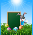 cartoon bunny waving hand with easter eggs and gre vector image