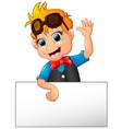 happy kid cartoon holding blank sign vector image vector image