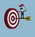 target with arrow and businessman holding flag vector image