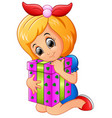 happy little girl cartoon holding birthday gift bo vector image vector image
